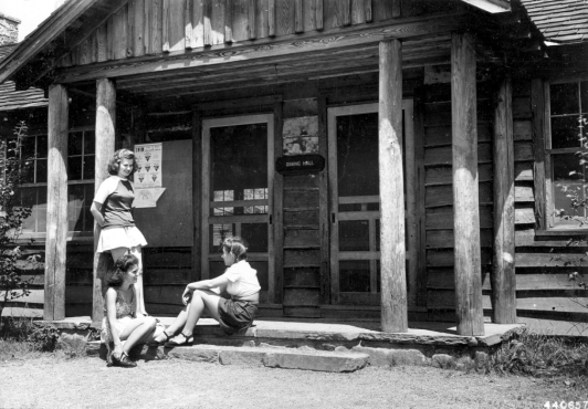 Girls socializing in front of the dining hall at Camp Horseshoe, 1946
